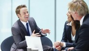 Portrait of executives having healthy discussion in office