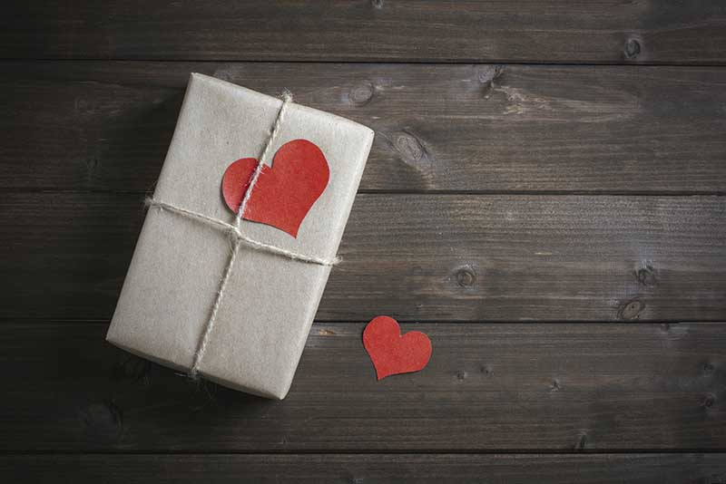 wrapped in kraft paper gift for Valentine's Day with red hearts