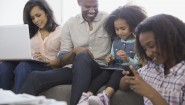 Family using wireless devices at home