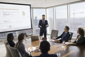 Marketer presenting key marketing metrics to his c-suite