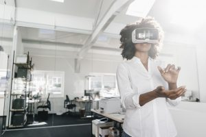 virtual reality goggles on a woman in an office
